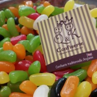 Logo de QK confiserie dans les bonbons